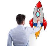 Zakenman die een raket trekken Concept bedrijfsverbetering en ondernemingsopstarten stock foto