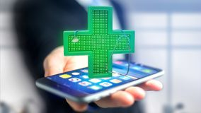 Zakenman die een smartphone met een kruis gebruiken van de Verlichtingsapotheek Royalty-vrije Stock Fotografie
