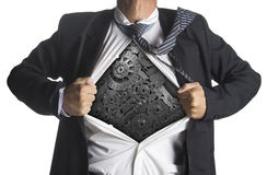 Zakenman die een superherokostuum onderaan machines tonen Royalty-vrije Stock Afbeelding