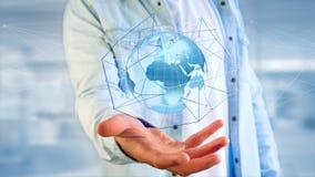 Zakenman die een Verbonden netwerk over een conce van de aardebol houden Stock Foto