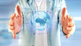 Zakenman die een Verbonden netwerk over een conce van de aardebol houden Royalty-vrije Stock Foto
