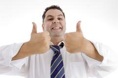 Zakenman die goedkeuring met omhoog duimen geeft Stock Afbeelding