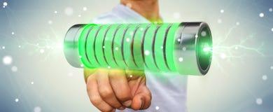 Zakenman die groene batterij met bliksem het 3D teruggeven met behulp van Royalty-vrije Stock Afbeelding