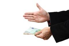 Zakenman die handdruk met geld aanbieden royalty-vrije stock afbeelding