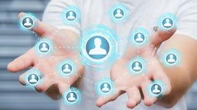 Zakenman die het blauwe sociale netwerk 3D teruggeven gebruiken Royalty-vrije Stock Afbeeldingen