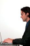 Zakenman die laptop met behulp van Stock Afbeelding