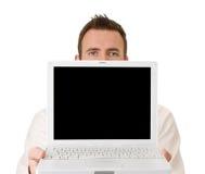 Zakenman die laptop met het knippen van weg steunt Royalty-vrije Stock Fotografie