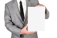 Zakenman die leeg document houden Royalty-vrije Stock Afbeeldingen