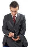 Zakenman die met PDA werkt Stock Afbeelding
