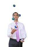 Zakenman die met zijn prioriteiten jongleert Stock Foto's