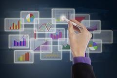 Zakenman die naald voor presentatie gebruiken Stock Afbeelding
