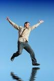 Zakenman die omhoog springt stock foto's