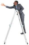 Zakenman die op ladder beklimmen royalty-vrije stock fotografie