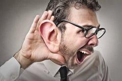 Zakenman die proberen te luisteren aan Stock Afbeeldingen