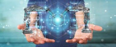 Zakenman die roboticawapens met het digitale het scherm 3D teruggeven met behulp van Royalty-vrije Stock Foto's
