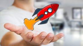 Zakenman die rode hand getrokken raket in zijn hand houden Royalty-vrije Stock Foto