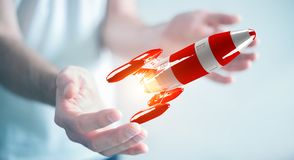 Zakenman die rode raket in zijn hand het 3D teruggeven houden Royalty-vrije Stock Fotografie