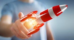 Zakenman die rode raket in zijn hand het 3D teruggeven houden Stock Afbeeldingen