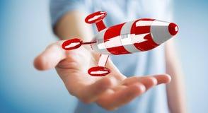 Zakenman die rode raket in zijn hand het 3D teruggeven houden Stock Foto's