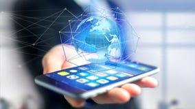 Zakenman die smartphone met een Verbonden netwerk over een oor gebruiken Stock Fotografie