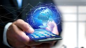 Zakenman die smartphone met een Verbonden netwerk over een oor gebruiken Royalty-vrije Stock Afbeeldingen