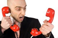 Zakenman die in telefoon schreeuwt royalty-vrije stock afbeeldingen