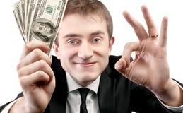 Zakenman die ventilator van geld en teken o.k. tonen Royalty-vrije Stock Fotografie