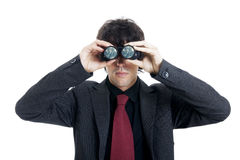 Zakenman die verrekijkers met behulp van Stock Afbeelding