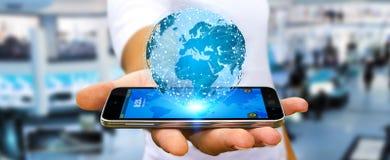 Zakenman die verschillende plaatsen van de wereld verbinden Stock Afbeelding