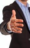 Zakenman die voor handdruk aanbieden stock foto's