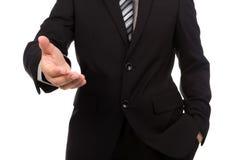 Zakenman die voor handdruk aanbiedt royalty-vrije stock afbeelding