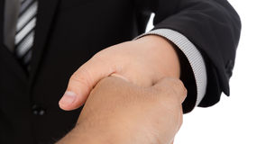 Zakenman die voor handdruk aanbiedt stock foto