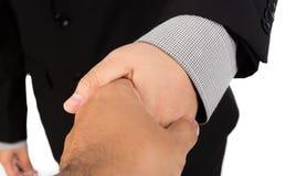 Zakenman die voor handdruk aanbiedt royalty-vrije stock foto's