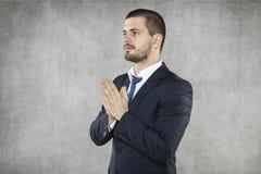 Zakenman die voor succes in zaken bidden royalty-vrije stock afbeeldingen