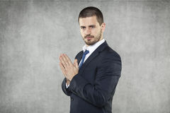 Zakenman die voor succes in zaken bidden stock fotografie