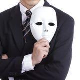 Zakenman die wit masker houden stock fotografie