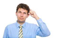 Zakenman die zijn hoofd, hard besluit krassen Stock Foto