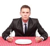 Zakenman die zijn maaltijd wacht Stock Foto