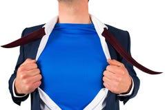 Zakenman die zijn stijl van overhemdssuperhero openen royalty-vrije stock afbeeldingen