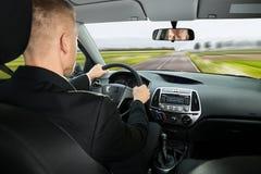 Zakenman Driving Car stock afbeeldingen