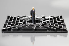 Zakenman in een labyrint Stock Foto