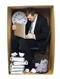 Zakenman in een strak bureau Stock Afbeelding