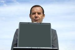 Zakenman en laptop stock afbeeldingen