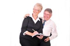 Zakenman en Secretaresse die Nota's nemen Stock Fotografie