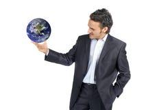 Zakenman en wereld stock foto