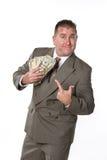 Zakenman en zijn contant geld Royalty-vrije Stock Foto's