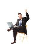 Zakenman en zijn laptop royalty-vrije stock fotografie