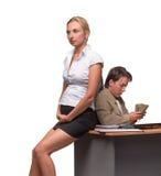Zakenman en zwangere secretaresse stock fotografie