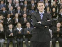 Zakenman In Front Of Multiethnic Executives Royalty-vrije Stock Foto's