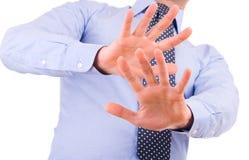 Zakenman het gesturing met beide handen. Stock Foto